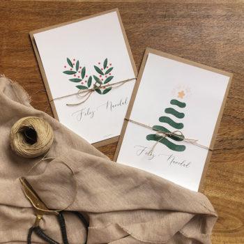 Pack de 2 felicitaciones navideñas con diseños originales de La Tortuguita Blanca. Unas ramitas de acebo y un abeto con su estrella de Navidad.
